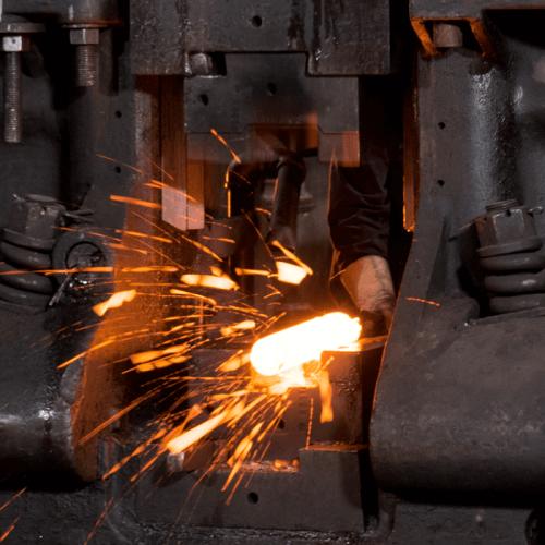 A worker forging metal.